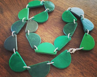 It's not easy being green. Handmade polymer clay scallop necklace - shades of green.