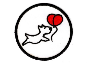 Dog chasing balloon Iron on Patch