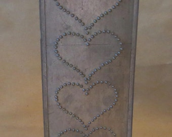 A Pierced Tin Wall Hanging Candle Holder