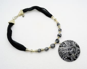 Elegant Handmade Beaded Necklace. Black, Gray and White Concave Pendant and Beads created from Polymer Clay and  Fabric. 16 inch long.