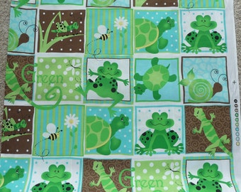 Frogs, turtles, salimanders, bees, grasshoppers, flowers fabric with multicolored backgroun