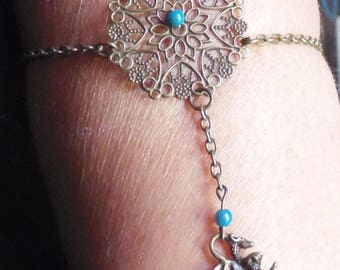 Bracelet or jewel of bronze arm and his small dragon