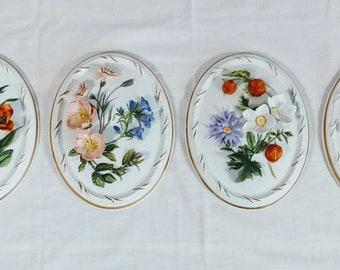 """Franklin Porcelain """"The Four Seasons"""" by Maureen Jensen Hand Painted Wall Plaques (set of 4)"""