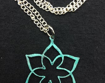 Hand-sawed Patina Flower Pendant