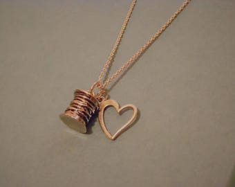 A Sewing Love Silvertone Spool of Thread Necklace
