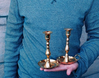 Two lacquered brass candlesticks