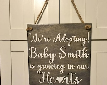 We're Adopting! A Baby is growing in our HEARTS! PERSONALIZED last name New Baby Announcement Sign Photo Prop