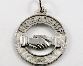 Two People Shaking Hands Friendship Sterling Silver Pendant or Charm.