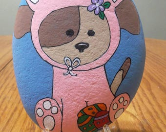 Hand painted rock Dog in Easter Bunny Suit