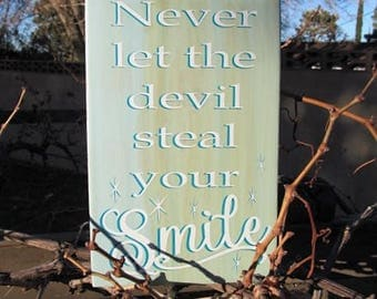 "Custom sign..""Never let the devil steal your Smile"" Two tone lettering overlay, Blue white and natural stain background 7.5 x 11"" Great Gift"