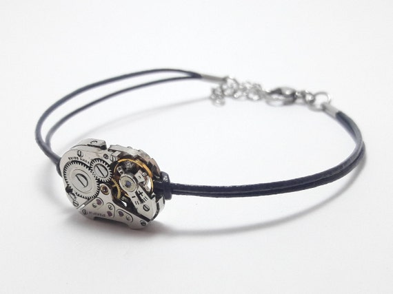 Silver watch mechanism on dark gray leather women bracelet