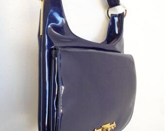Vintage like-new blue patent leather 1960s era purse with adjustable length shoulder strap - By Robert Bestien