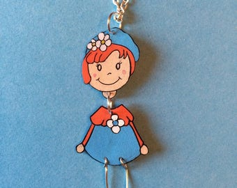 Little girl and blue and orange flower necklace