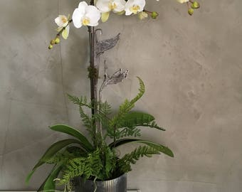 White artificial phalaenopsis orchid plant in zinc container with faux fern