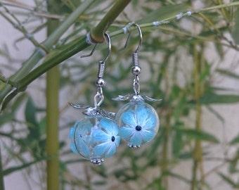 Earrings green jade color flower glass beads.
