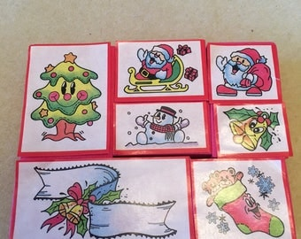 Seven Christmas Stamps.Tree,Santas,Snowman,Bell,Stocking & Ribbon.