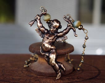 French Brass Cherub Cupid Necklace with Pyrite Chain and Sky Blue Beads