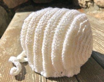 Supersoft merino wool baby soft bonnet created. White newborn bonnet.