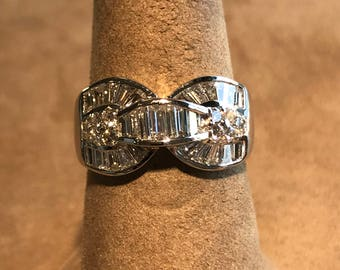 18 Kt White Gold Baguette and Round cut Diamond Ring