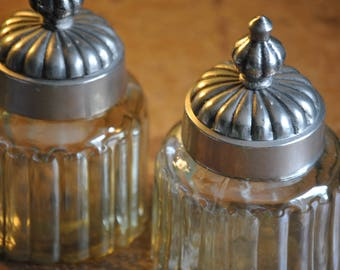 Pair of Elegant Vintage Indian Vanity Jars. Smokey Glass Jars Topped with Metal Eastern Styled Lids. Highly Attractive and very Useful!!