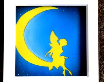 Original hand cut papercut. Fairy on the moon.