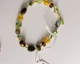 Multi coloured Boho-chic anklet handmade with trade beads. For festivals and summer wear.