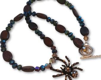 Black Sand, Goldstone Gemstone And Crystal Spider Pendant Necklace
