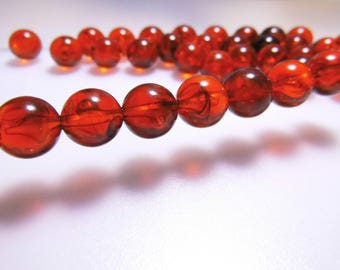 18 beads 12mm red cat's eye