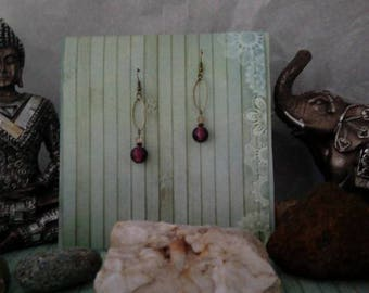 A pair of earrings in bronze and purple beads from India