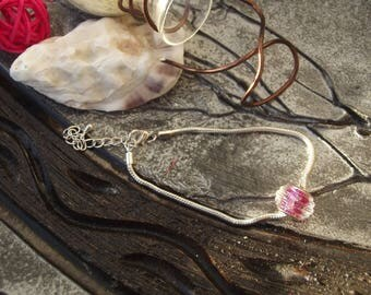 Women bracelet silver snake with large flattened Pearl transparent and pink glitter.