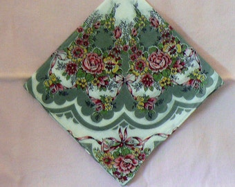 Lady's vintage cotton retro floral hankie with pink flowers and rolled hem