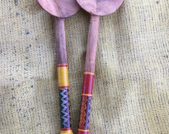 Hand carved and painted wooden spoon.