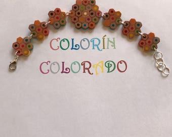 Handmade, bracelet with colored pencils.