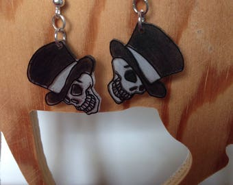 Black and white skull earring
