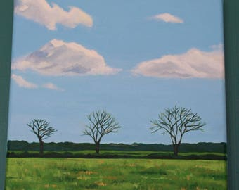 Blue sky, three trees