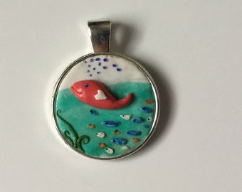 Singing with the pink whale pendant