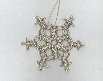 Handmade silver craft cord macrame snowflake by TwistedandKnottyUS