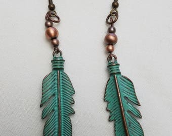 Antiqued feather earrings