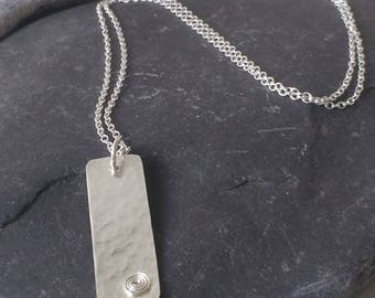 Silver hammered pendant with coil detail