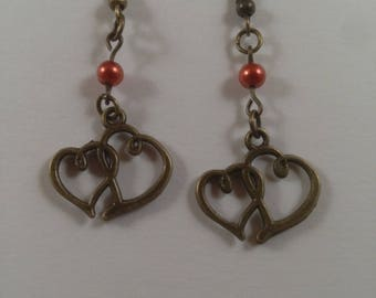 Antique bronze earrings with orange accents.
