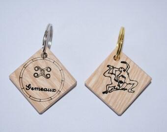 Zodiac sign Gemini wooden keychain.