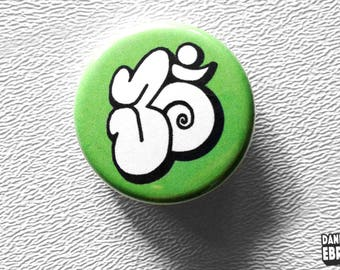 Om button pin