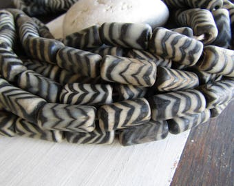 tube Lampwork glass beads, black white striped , matte opaque mild aged gritty look   , feather ethnic design indonesia  ( 4 beads) 7ab18