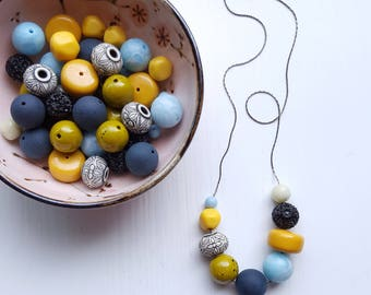 cairo necklace - vintage lucite, remixed - muted colors - mustard, black, light blue, olive