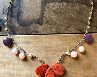 Handwoven Beaded Necklace with Coral Pendant