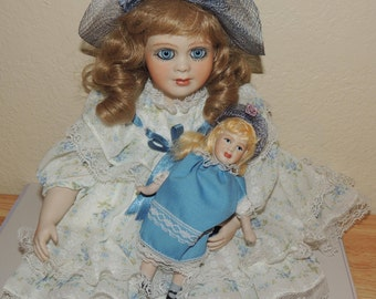 Porcelain Little Girl and her Doll