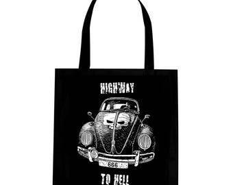 black tote bag with car ladybug and skull on it