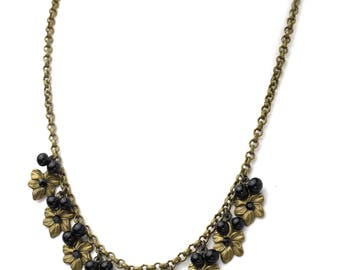 Vintage Brass Flower Charm Necklace with Black Onyx and Swarovski Crystals