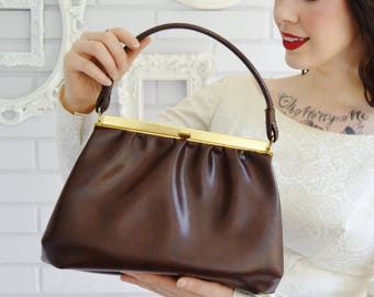 Vintage Brown Faux Leather Handbag with Gold Tone Metal Clasp and Dark Brown Nylon Lining