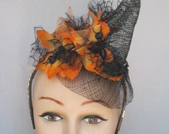 Spooky Black Open Woven Scarecrow Hat with Crawling Black Ants on Orange Flowers on an Orange Crystal Hat Band